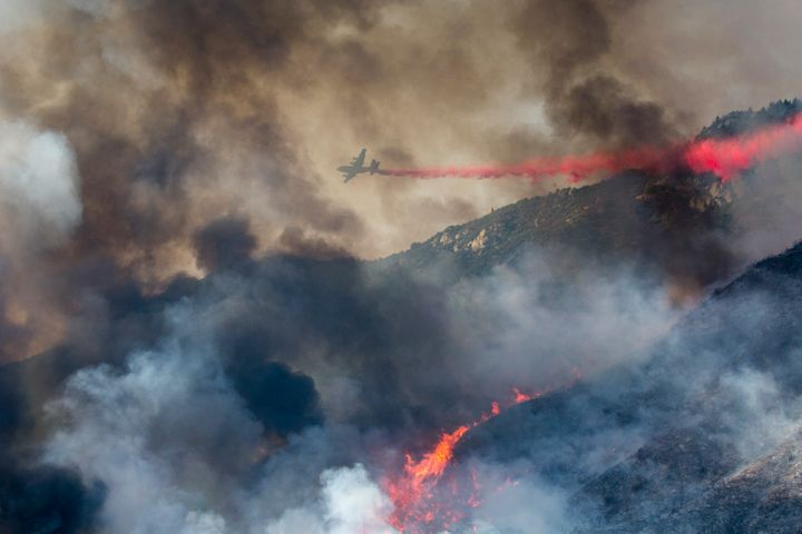 A wildfire burns at a hillside in Yucaipa, Calif., Saturday, Sept. 5, 2020. A brutal heat wave pushed temperatures above 100