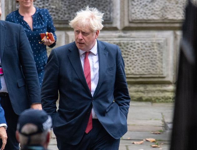 Prime Minister Boris Johnson leaves the Foreign and Commonwealth Office in London following a meeting...