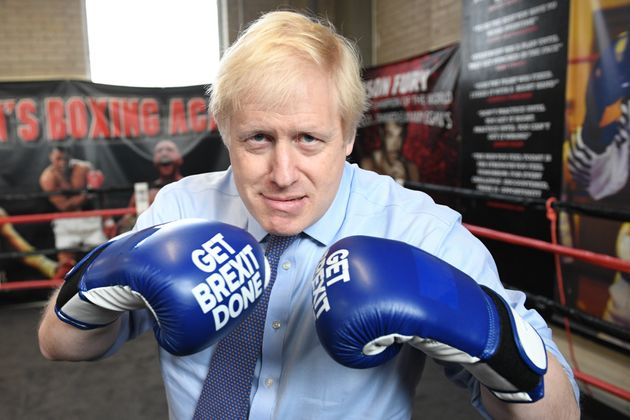Johnson on a visit to a boxing club during December's