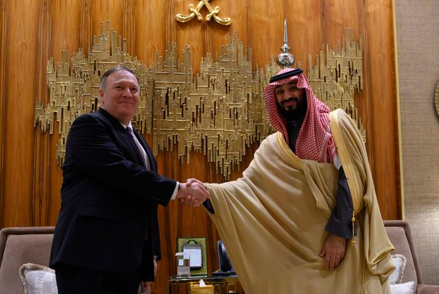 U.S. Secretary of State Mike Pompeo, left, shakes hands with Saudi Arabia's Crown Prince Mohammed bin...