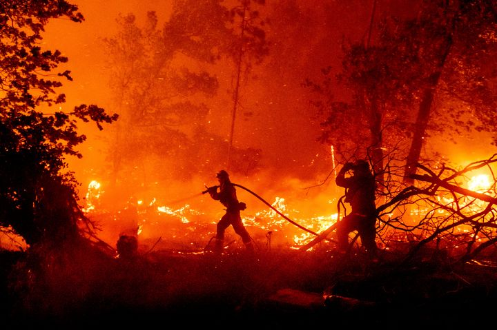 Firefighters battle the Creek Fire as it threatens homes in the Cascadel Woods neighborhood of Madera County, Calif., on Mond