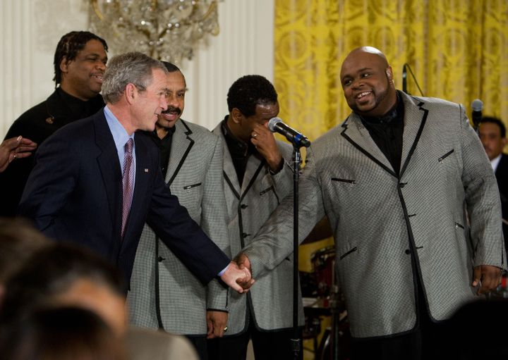 President George W. Bush shakes hands with Bruce Williamson of The Temptations on Feb. 12, 2008 at White House in Washington,