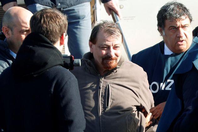 Former Italian leftist guerrilla Cesare Battisti arrives at Ciampino airport in Rome, Italy, January...