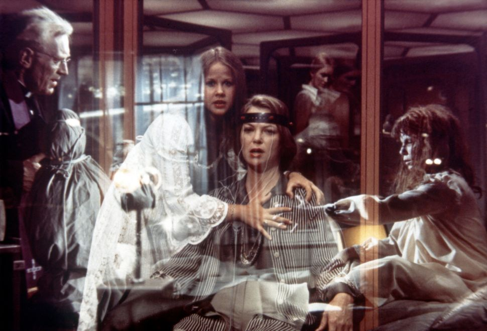 "Max von Sydow, Linda Blair and Fletcher in ""Exorcist II: The Heretic."""