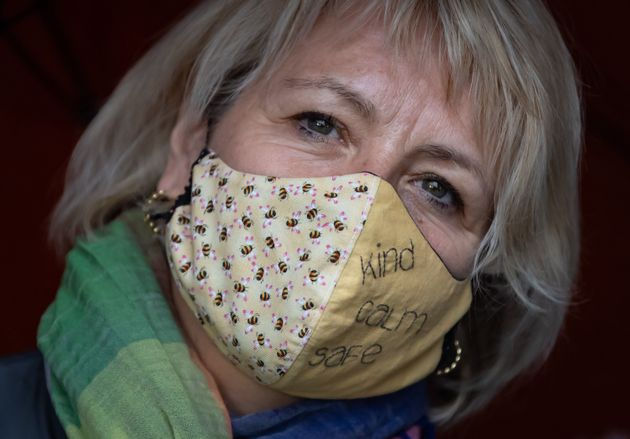 British Columbia provincial health officer Dr. Bonnie Henry wears a face mask as she visits Vancouver...
