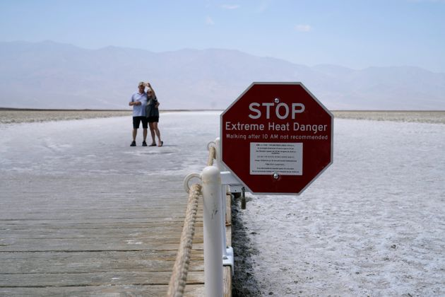 A sign warns of extreme heat danger at Badwater Basin, Monday, Aug. 17, 2020, in Death Valley National...