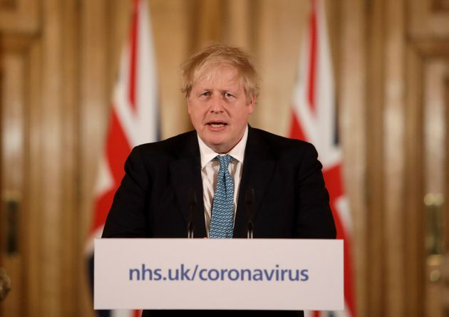 Prime Minister Boris Johnson gives a press conference inside 10 Downing Street in London.