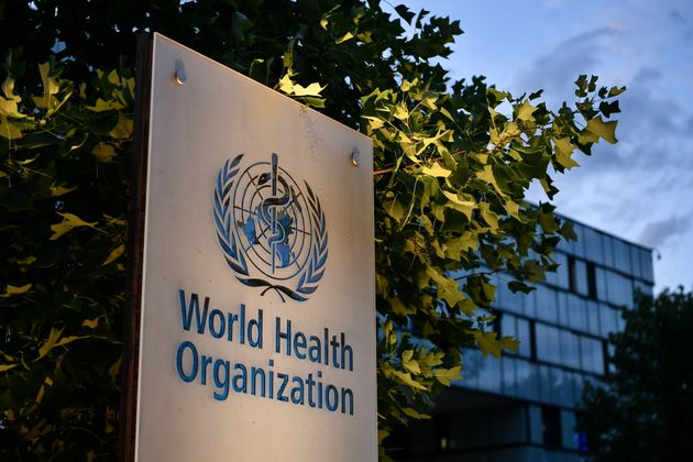 A photo taken in the late hours of August 17, 2020 shows a sign of the World Health Organization (WHO)...