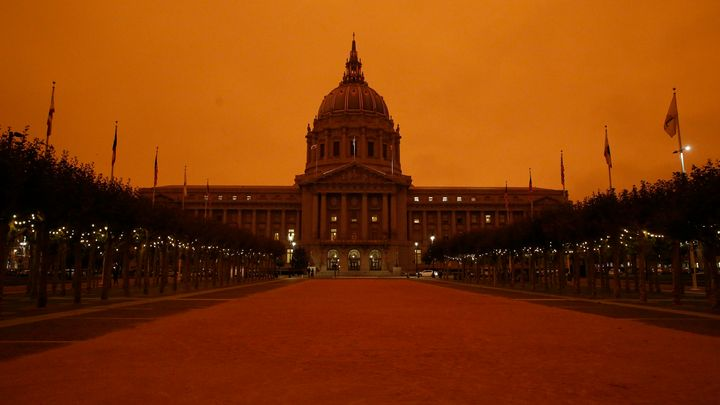 San Francisco City Hall under a sky glowing orange due to wildfire smoke on Sept. 9, 2020.