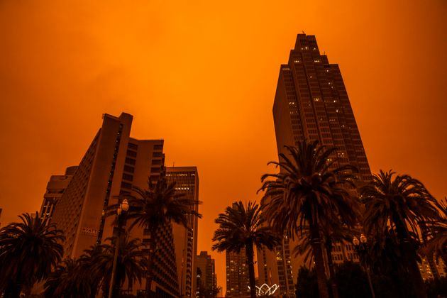 An orange glow fills the sky above the Embarcadero as smoke from various wildfires burning across Northern...