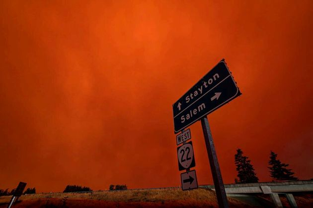 Red sky and thick smoke are seen in Salem City, Oregon, U.S., September 8, 2020, in this picture obtained...