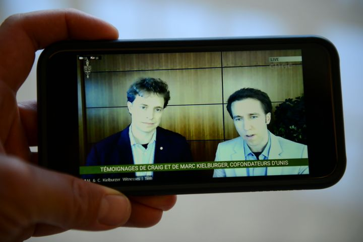 Marc Kielburger, left, and Craig Kielburger, right, are pictured on CPAC as they appear as witnesses via videoconference during a House of Commons finance committee in Ottawa on July 28, 2020.