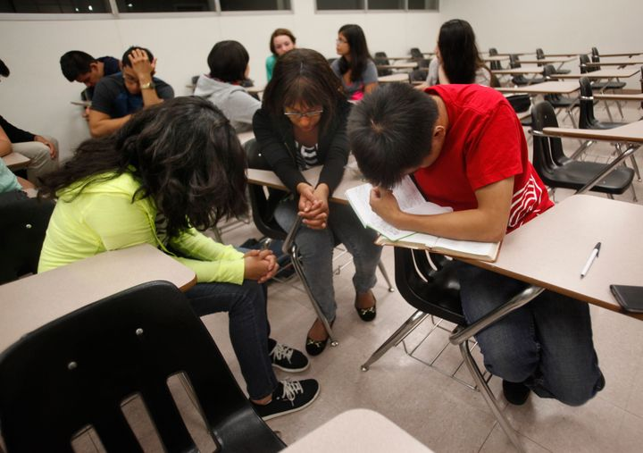 Students pray during an Intervarsity Christian Fellowship meeting at Cal State Northridge in September 2014.