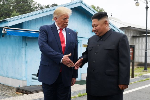 Trump meets with North Korean leader Kim Jong Un at the border village of Panmunjom in the Demilitarized...