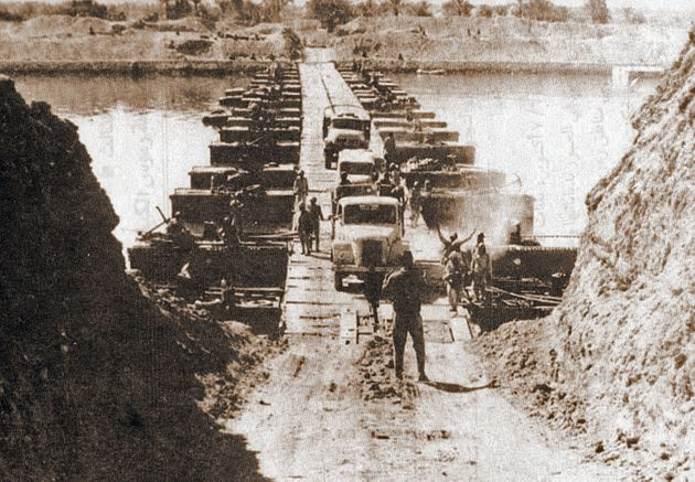 Egyptian military trucks crossing a bridge on Suez Canal during Yom Kippur War, 7th October