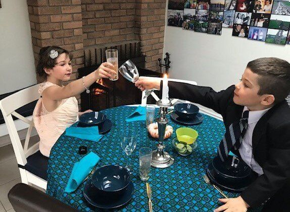 The author's children got dressed up in their parents' wedding clothes from nine years ago, in an effort topretend they were at the wedding.