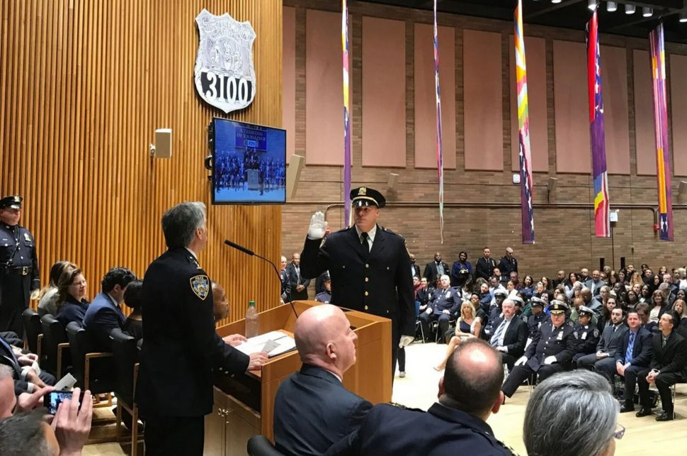 Christopher McCormack is sworn in as a deputy chief during a 2017 ceremony at Police Headquarters. (NYPD)