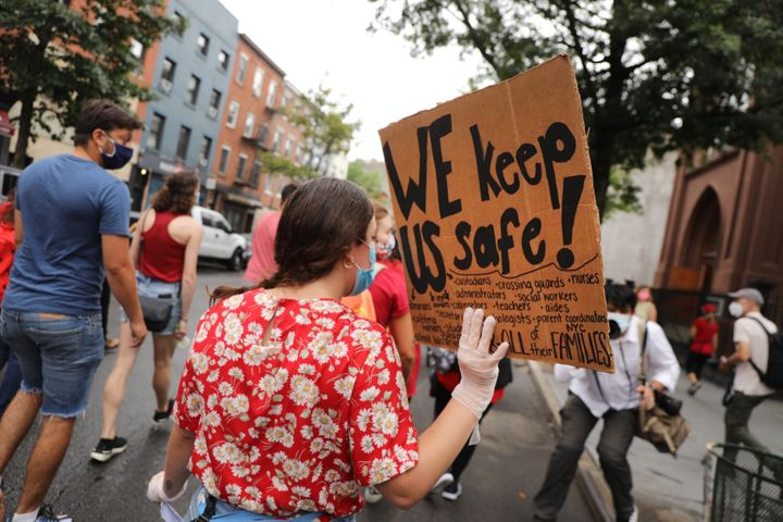 Members of the teachers union, parents and students participate in a march through Brooklyn, New York, on Sept. 1 to demand a