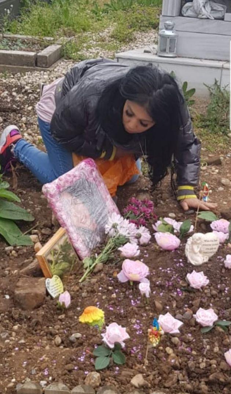 Mel Mustafa at sister's graveside
