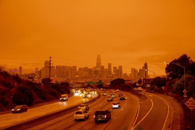 A layer of smoke generated by over two dozen wildfires burning in California created and eerie orange...