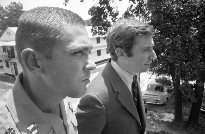 Captain Jeffrey MacDonald (L) is shown in 7/17/1970 file photo conferring with his attorney, Dennis Eisman.  MacDonald was se