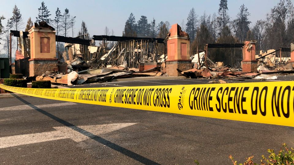 The ruins of a shopping mall in Phoenix, Oregon, are seen Thursday after fire swept through the area