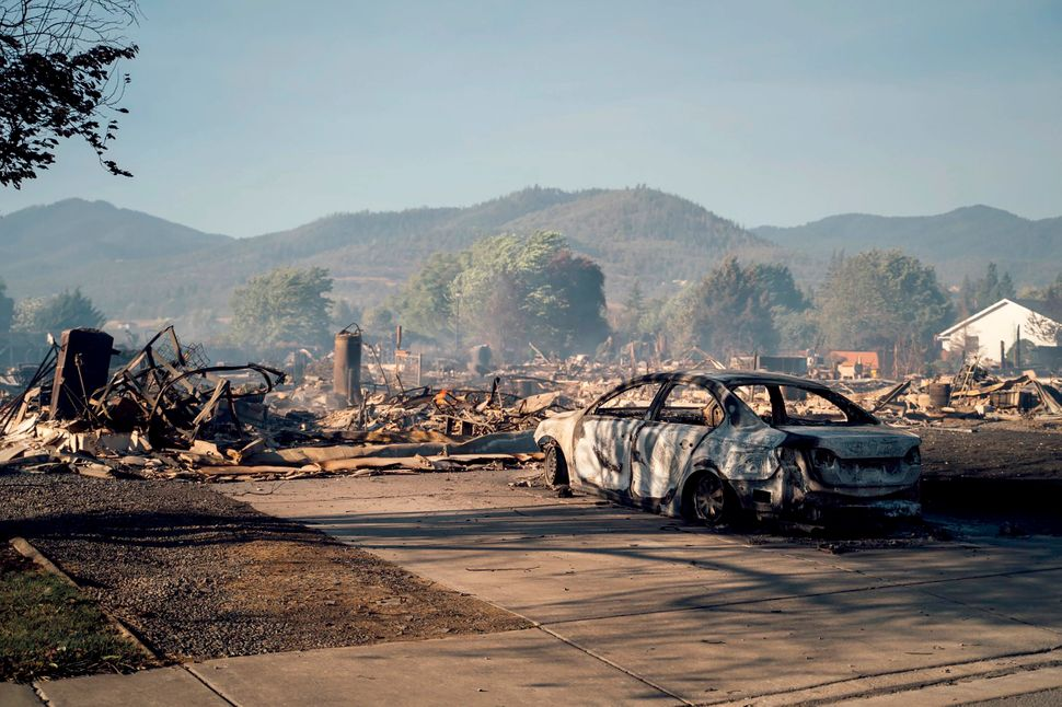 This photo taken by Talent, Oregon, resident Kevin Jantzer shows the destruction of his hometown Wednesday after wildfires ra