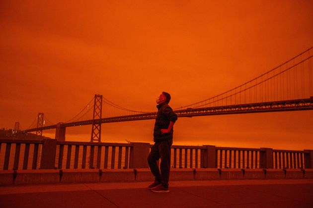 Smoke from the Northern California wildfires casts a reddish color over the Embarcadero in San Francisco...