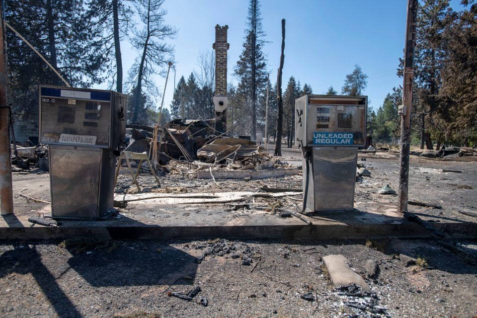 A service station is destroyed Tuesday after Malden, Washington, is overrun by wildfire. High winds kicked up flames across the Pacific Northwest on Monday and Tuesday, burning hundreds of thousands of acres.