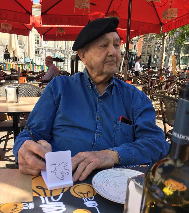 The author's father sketching the author's mother at Plaza de Santa Ana in Madrid, Spain, in March. He died of COVID-19 later