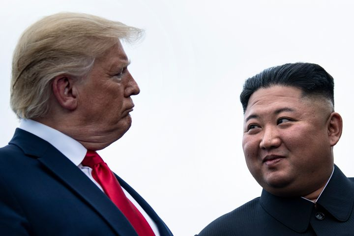 President Donald Trump and North Korea's leader, Kim Jong Un, talk before a meeting in the Demilitarized Zone on June 30, 201