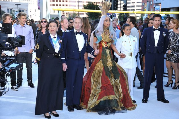Gaga in her original VMAs outfit, with four LGBTQ veterans