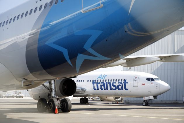 An Air Transat aircraft sits on the tarmac at Toronto Pearson International Airport on April 8, 2020....