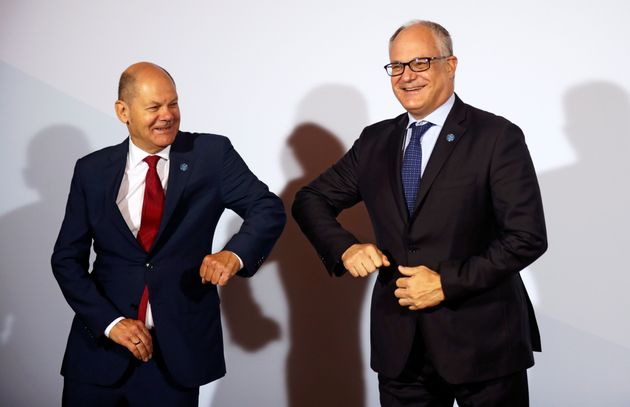 Italian Finance Minister Roberto Gualtieri (R) is welcomed by German Finance Minister Olaf Scholz is...