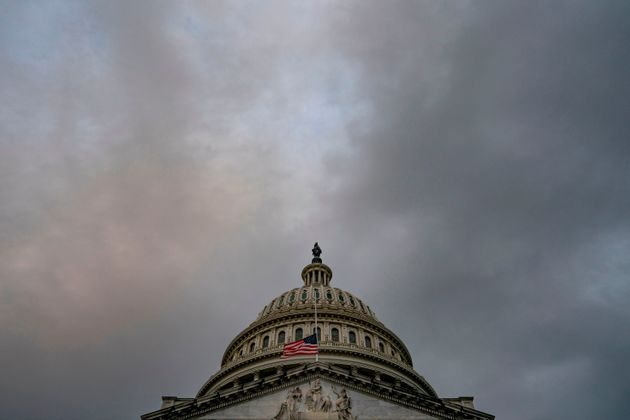 The US flag flies at half-staff at the US Capitol on September 11, 2020 in Washington, DC, in remembrance...