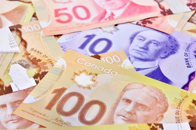 Canadian banknotes are seen here in this stock image. Canadian householdsnow have $1.58 in credit...