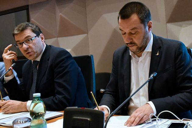 Secretary of the Council of Ministers Giancarlo Giorgetti (L) and Italy's Interior Minister and deputy...
