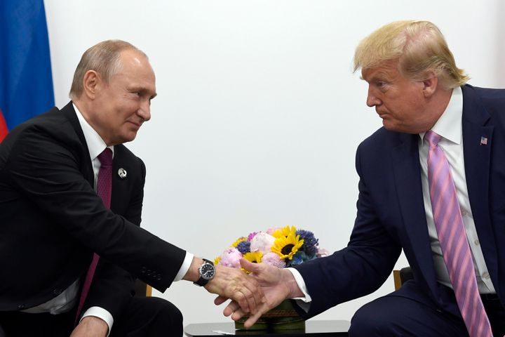 Russian President Vladimir Putin shakes hands with President Donald Trump during the G-20 summit in Osaka, Japan, in June 201
