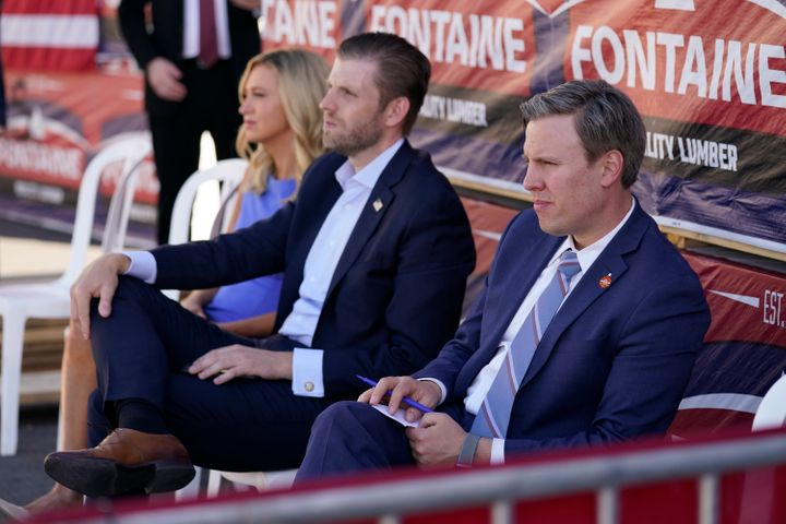 From left, White House press secretary Kayleigh McEnany, Eric Trump and campaign manager Bill Stepien listen as President Don