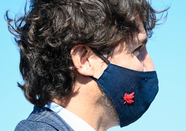 Canadian Prime Minister Justin Trudeau wear his mask as he takes part in a ground breaking event at the...