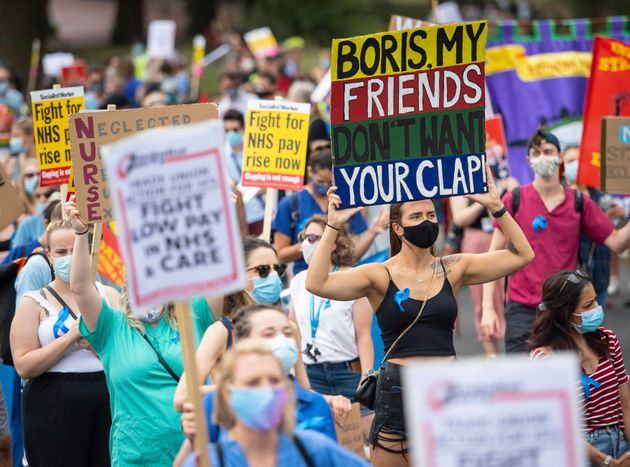 National Health Service (NHS) workers march from St. James' Park to Downing Street, London, Saturday...