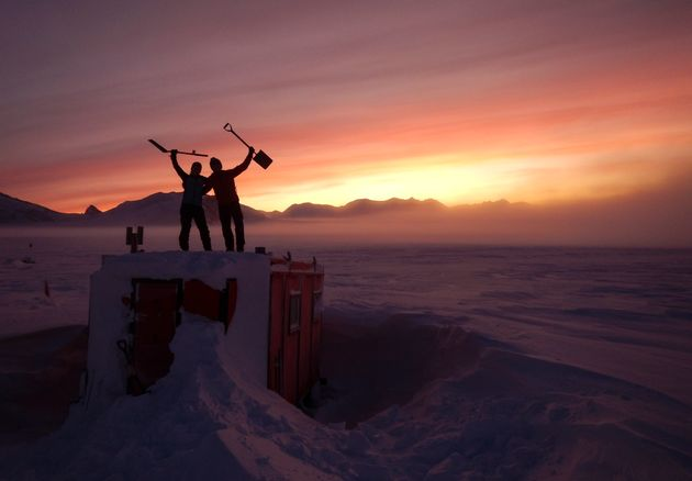 In this handout photo provided by British Antarctic Survey, field guides Sarah Crowsley, left, and Sam...