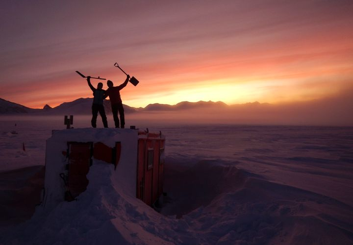 In this handout photo provided by British Antarctic Survey, field guides Sarah Crowsley, left, and Sam Hunt, right, pose for