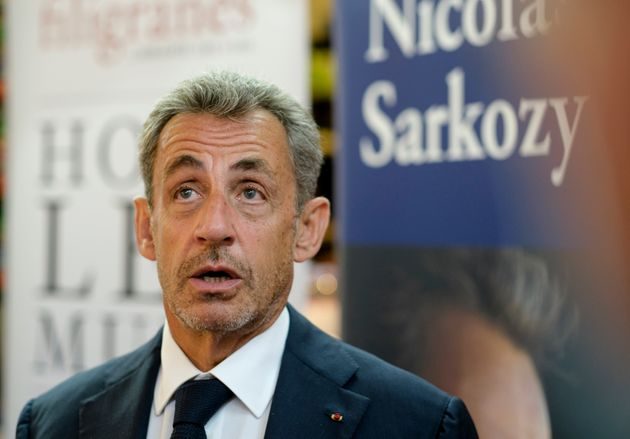 BRUSSELS, BELGIUM - SEPTEMBER 3: Former French President Nicolas Sarkozy signs his latest book
