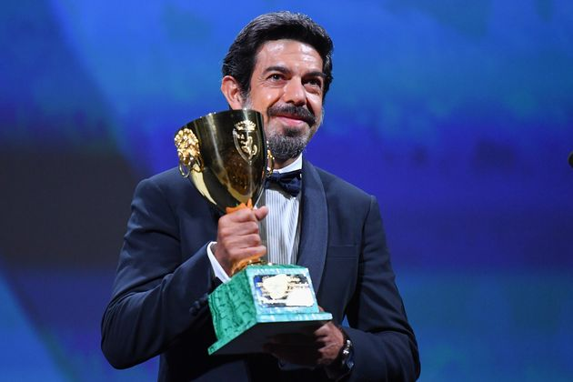 VENICE, ITALY - SEPTEMBER 12: Pierfrancesco Favino poses with the Coppa Volpi for Best Actor during the...