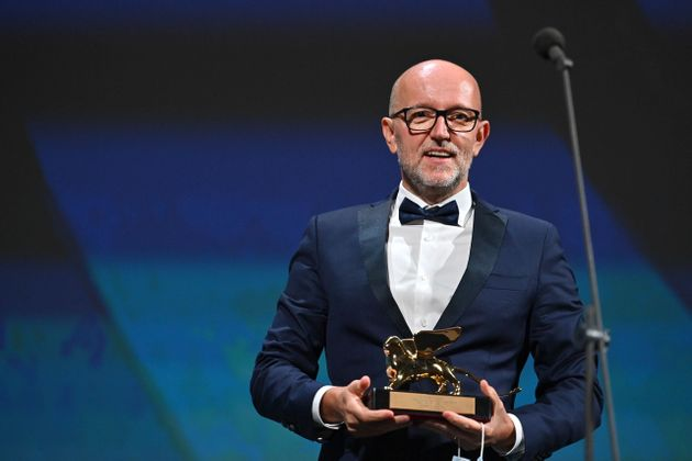 Disney's Marketing Director for Italy, Davide Romani acknowledges receiving the Golden Lion for Best...