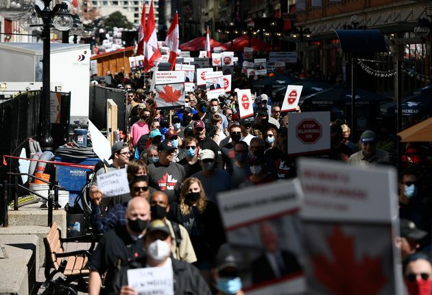 Gun owners march along Sparks Street during a rally organized by the Canadian Coalition for Firearm Rights...