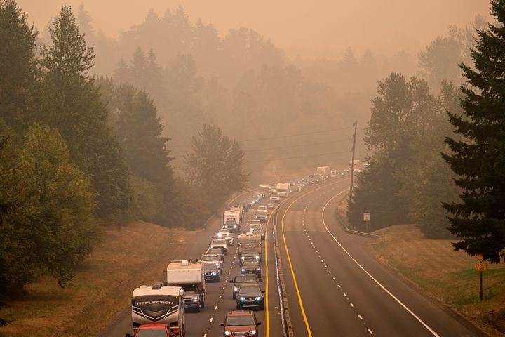 Oregon residents evacuate north along highway Highway 213 on Sept. 9 near Oregon City, Oregon. Multiple wildfires grew by hun