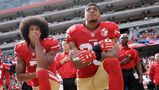 FILE - In this Oct. 2, 2016 file photo, San Francisco 49ers quarterback Colin Kaepernick, left, and safety Eric Reid kneel during the national anthem before an NFL football game against the Dallas Cowboys, in Santa Clara, Calif. Colin Kaepernick and Eric Reid have reached settlements on their collusion lawsuits against the NFL, the league said Friday, Feb. 19, 2019.(AP Photo/Marcio Jose Sanchez, File)