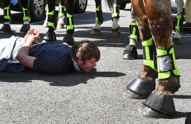 Police detain an anti-lockdown protester at Melbourne's Queen Victoria Market during a rally on September...
